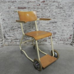 Vintage chair on wheels,...